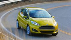 2014 Ford Fiesta. This 1.0-liter 3-cylinder turbo engine gets the job done.