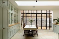 The dream kitchen; crittall style windows and beautiful fitted bespoke cabinets by deVOL
