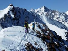 Art Burrows (right) explores Highlands Ridge for possible new descent variations with snowboard rider Pete Gaston.
