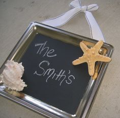 Silver chalkboard tray sign with seashell, starfish, and beach ribbon accents. $16.50, via Etsy.