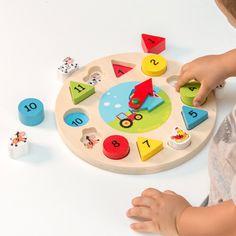 Reloj-Puzzle Didáctico de Madera (13 piezas) - 730 Consigue ya el juego educativo de moda entre los más pequeños el reloj-puzzle didáctico de madera! Ideal para que los niños se diviertan aprendiendo números colores formas geométricas y...