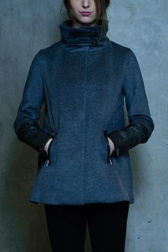 Wool and Cashmere blend swing cape coat with high neck collar with leather belt on the neck. Zip pockets on the hip. Zip cuff along the sleeve. Cashmere Cape, Cape Coat, Neck Collar, Lambskin Leather, S Models, Hooded Jacket, Hand Weaving, Wool, Link
