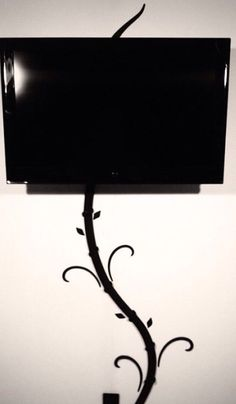 Hide tv and digital picture frame cords without cutting holes in your wall with my creation the Tv-Tree.