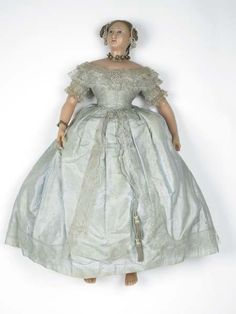 PORTRAIT DOLL 1851 This luxury wax doll of Queen Victoria was made by Augusta Montanari, an Englishwoman, and her Corsican husband Napoleon. Victorian Dolls, Antique Dolls, Vintage Dolls, Victorian Games, Victorian Era, Pale Blue Dresses, Blue Silk Dress, Queen Victoria Prince Albert, Victoria And Albert