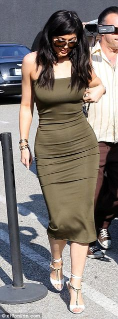 Kim-itation: Kylie channeled her sister's look down to the large glasses and long dark hai...