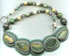 petrified wood, seed beads, silver, turquoise.... wow!