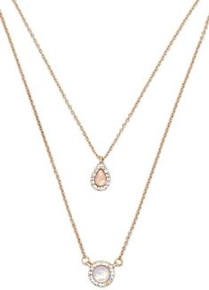 Forever 21 Layered Iridescent Necklace Set A high-polish necklace set featuring iridescent faux gem pendants encrusted with rhinestones, and a lobster clasp closure. $4.90