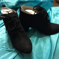 Black Ariana bootie New In Box Has man made material with a coating on top of material. Color on one has a little in perfection on color in spot in pictures . Has A 2 1/2  stacked heel . Comfortview Shoes