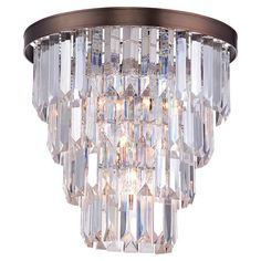 A glittering addition to your home, this glamorous semi-flush mount features a cascade of cut prisms for glimmering style.  Product:...