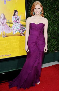 plum Oscar de la Renta strapless gown teamed with turquoise earrings