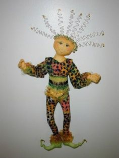 """Izzy This whimsical 16"""" wall doll with wild hair and many embellishment options is fun and fast to sew.  Cloth Doll Making (Sewing) Patterns by  Cynthia Sieving"""