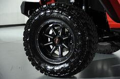 Custom 2014 Jeep Wrangler Unlimited in Flame Red Kevlar Exterior: Custom Wheel and Tire