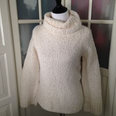 Cream express hand knit sweater Cream sweater with oversized neck. Just makes you want to cuddle up with some cocoa! Very soft. Size small. Express hand knit collection. Express Sweaters Cowl & Turtlenecks