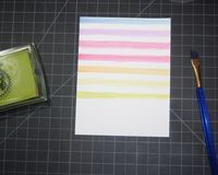 Cool tip for getting the watercolor look: Pair pigment ink pads with water (in a waterbrush) and get watercolor stripes. Click on the photo for the post with the how-to from Heather Campbell in Ellen Hutson's CLASSroom.