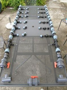 PVC pipework fittings layout before installation in solar pool heating system.