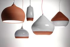 This series of terracotta lamps was created by London's Hand & Eye Design studio.