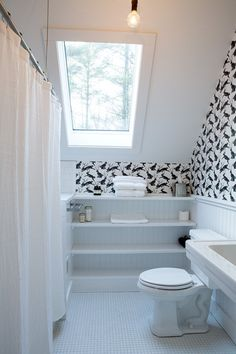 A bathroom in the HIllside Schoolhouse, an inn in Vermont, with Jackalope wallpaper from Spoonflower.