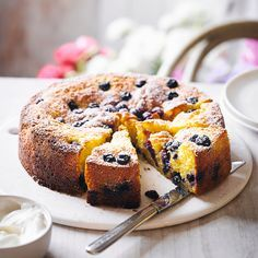 This beautiful spongy polenta cake is great for sharing with family and friends. The orange sponge filled with Waitrose' blueberries makes for a scrumptious dessert.