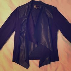 Navy Vegan Leather Jacket Worn only once for an interview. Fits great! Super soft vegan leather front and shoulders, the rest is a rayon/spandex blend ensuring a snug fit. Three navy snap buttons at each sleeve. Kut from the Kloth Jackets & Coats