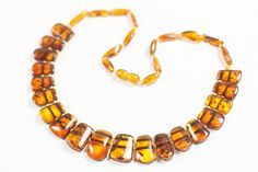 Luxury Baltic amber necklace. Natural polished cognac amber beads.