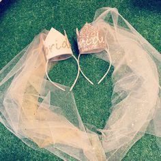 This super cute mini gold Bride crown headband is a gorgeous statement accessory for the bride. It has a veil and the crown is attached to a hairband.