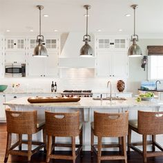 classic nautical bright white kitchen with wicker, chrome, marble