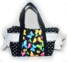 Handmade handbag - Lace Butterfly on black Nappy Handbag  AUD79.00 Lace and butterflies is back in fashion. Features a sweet lace bow on both sides of the bag. Inside is fully lined with 6 inside pockets and 1 inner zipper pocket as shown. Ideal for creams and other knicknacks. Magnetic snap closure.   Dimensions: 29cm wide X 20cm (tall without strap), 40cm (tall including strap), 14 cm depth.  http://www.imusthavethat.com.au/pd-handmade-handbag---lace-butterfly-on-black-nappy-handbag.cfm