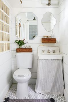 """Teeny-tiny bathrooms can be just as functional as sprawling master suites. With a few strategic moves, they're bright and full of places to put things.Some older bathrooms come with sinks that have exposed (and unsightly) plumbing underneath them. Cover it up —€"""" and give yourself an extra spot to stash supplies —"""" with just a yard or two of fabric."""
