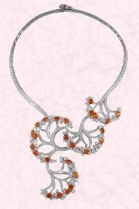 Van Cleef & Arpels Castalie neckpiece. The Castalie Necklace is set in White gold to enhance round diamonds and orange, gold, mandarin garne...
