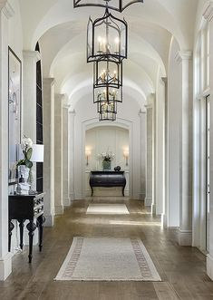 Kim Kardashian and Kanye West's hallway. Simple and beautiful. The light wooden floors compliment the light interior and make the space look larger. Stunning.