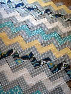 Zig Zag Quilt Piecing - she explains very simply how this is achieved. You could alter it to use wider strips and make bigger blocks so it's a bolder look with just a few zig zags