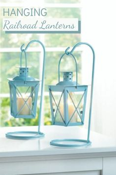 Add soft lighting and the charm of glass and iron railroad lanterns to your baby shower, buffet table, or Al Fresco dinner party. 3.875x3.875x9, set of 2. Available in blue or white. Hanging Candle Lanterns, Small Lanterns, Wooden Lanterns, Candle Lighting, Pillar Candle Holders, Candle Stand, Blue Centerpieces, Lantern Set, Tea Lights