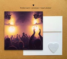 Blank photo card printed on recycled paper // shared with love // profits support clean water projects // crowd cheering at a UK concert (©James Caddice)
