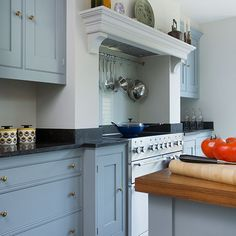 Versatility is not an issue for the Mercury as seen here in a more traditional styled blue grey kitchen with limestone worktop.