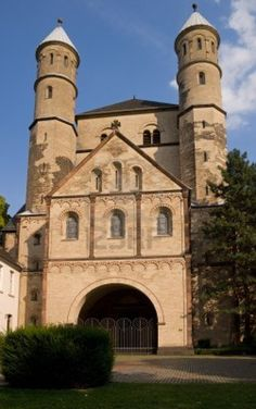 Front facade of St. Pantaleon church in Cologne (Koeln, Germany). The church dates back to the 10th century and is the oldest of the 12 Romanesque churches in Cologne. Stock Photo