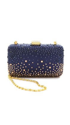 Dripping in rich blue and gleaming gold crystals,such a pretty clutch this is !