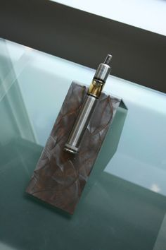Ground Metal Electronic Cigarette Holder with a sleek modern look.