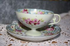 Unique beautiful handpainted floral teacup by FranklinStVintage