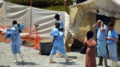 World Health Organization Says Death Toll From Ebola Outbreak In West Africa Now At Least 121 - Health workers walk in an isolation center for people infected with Ebola at Donka Hospital in Conakry, April 14, 2014.