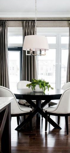 Atmosphere Interior Design: Home Lottery Spring 2013. Love the use of black, the white leather chairs with nailhead trim, the chandelier. The dark wood floor keeps it all grounded....V