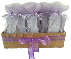 e7bd36fe05914 A soft lavender accents this white combination. The flip flop in the  organza bag great for bulk wedding reception guest.