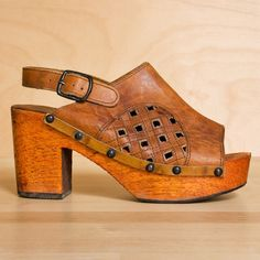 Wood platforms 6.5. Vintage 1970s tan leather wooden clogs by kenaione, $138.00