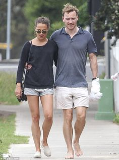 Happy couple: Michael Fassbender and Alicia Vikander confirm they are a couple as they stroll arm in arm in Sydney, Australia on Wednesday