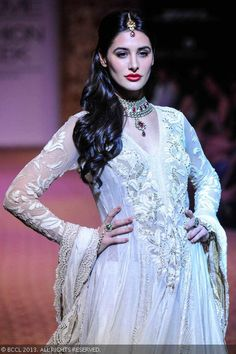 Nargis Fakhri walks the ramp for designer Ritu Kumar on Day 5 of the Lakme Fashion Week (LFW) Winter/Festive 2013. #Bollywood #Style #Fashion #LFW
