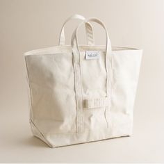Originally used to lug ice and coal, the all-American canvas carryall has evolved into a summer mainstay. Read on for more history and for five to buy.