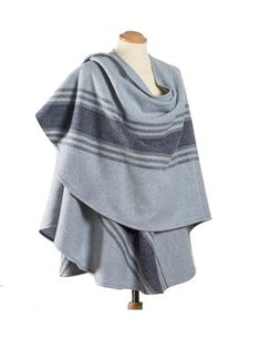 "Cape measures 33"" in the front and 29"" in the back and wrap around your body allowing you to wear it in various ways. Wrap it around both shoulders for maximum warmth, let it drape for a more relaxed look, or even wrap it around one shoulder! One size fits most. This beautiful cape is made by John Hanly and Co. in Co. Tipperary."
