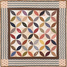 Civil War Quilt...Orange Peel pattern...Kathleen Tracy I made this quilt using wide rick rack to imitate the border fabric used in the pattern.