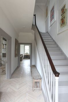 Putty taupe painted base trims..can see taupe stair rails with dark brown black glossy handrail top!