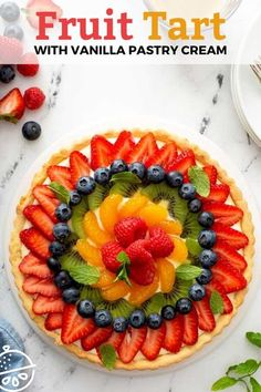 This Fruit Tart recipe has a sweet and crisp pastry crust, a rich vanilla custard filling and fresh ripe fruit lightly brushed with the easiest fruit tart glaze. This classic French Fruit Tart is a simple, yet elegant dessert sure to impress your family and friends. #lemonblossoms #desserts #French #fruit #pastrycream #easy French Fruit Tart Recipe, Fruit Flan Recipe, Fruit Tart Glaze, Fruit Custard Tart, Fresh Fruit Tart, Custard Filling, Ripe Fruit, Vanilla Custard, Fruit Tarts