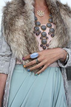 this ensemble is perfection. bib necklace, monogram filigree necklace, sea foam skirt, fur lined cardigan.